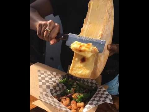 Broiled Suisse raclette cheese over garlic fried potatoes, with kale and...