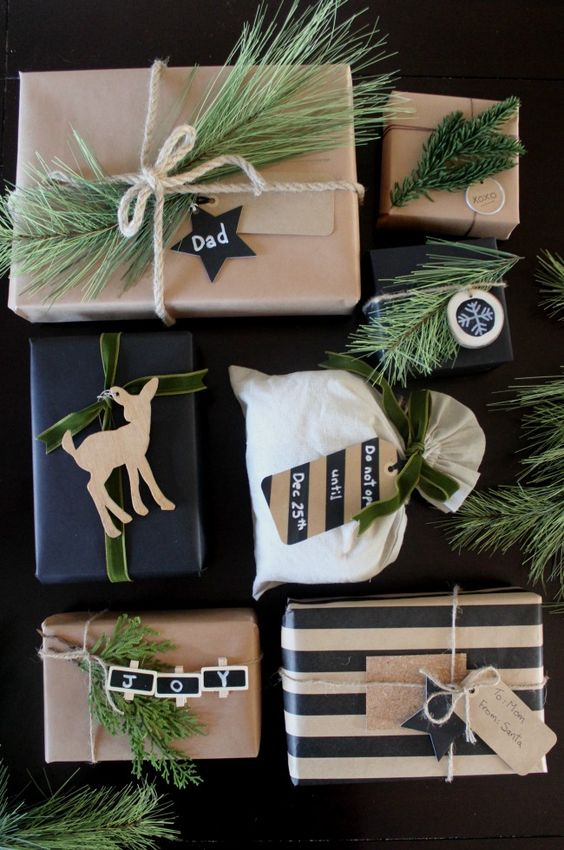 The perfect rustic gift wrapping ideas. I love the black, white and green. The greenery and wood and perfect natural elements!: