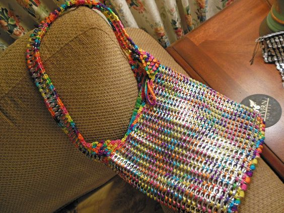 Just finished making this beautiful multi-colored pop top purse.  My own design.