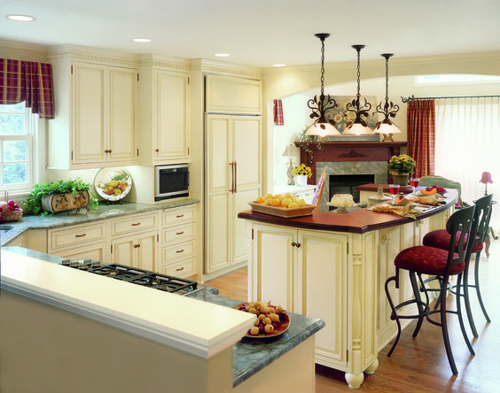 A Five Burner Gas Cooktop Highlights This Kitchen 39 S Cooking Zone Custom Birch Cabinets With A
