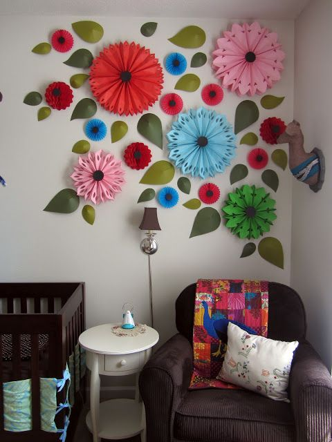 created blissfully: nursery.  Love the paper flowers.  They'll go great with the record butterflies I'm making!  :D