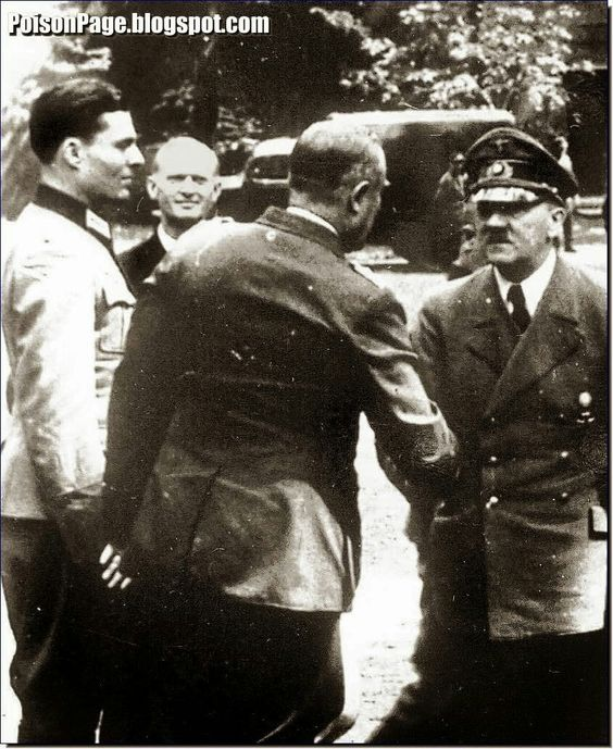 Stauffenberg (left) with Hitler at the Wolfsschanze, Rastenburg, five days before the assassination attempt. Also in the picture with his back is Friedrich Fromm, the commander in chief of the Reserve Army.