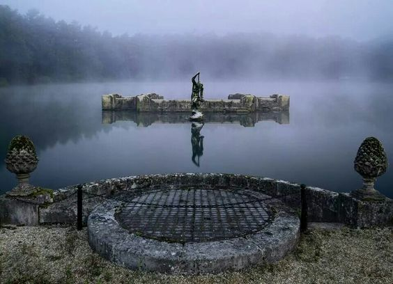 Neptune over lake on private island in south England