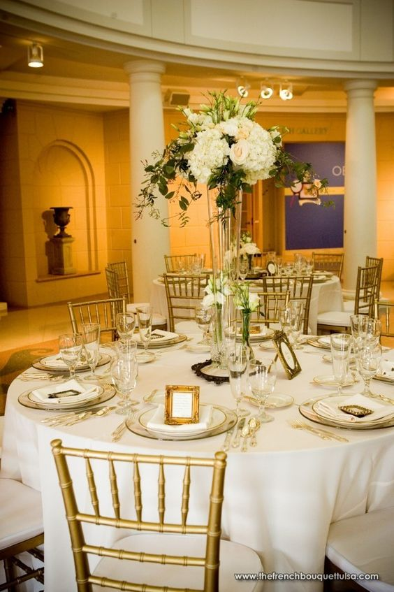 Elegant wedding centerpieces even one tall centerpiece