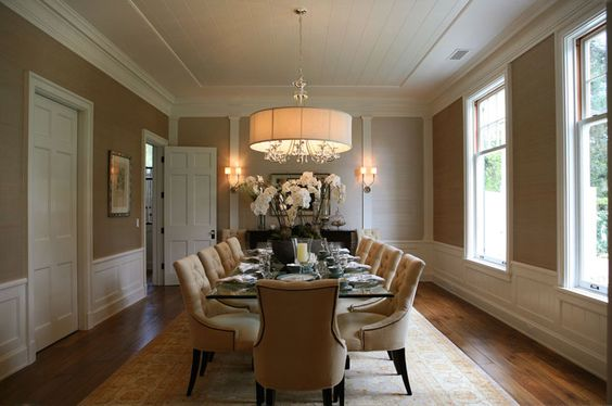 Elegant formal dining room design with wainscoting crown
