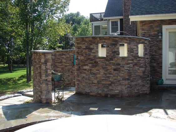 stone walls landscaping | The stone walls surrounding this outdoor shower spiral out like a ...
