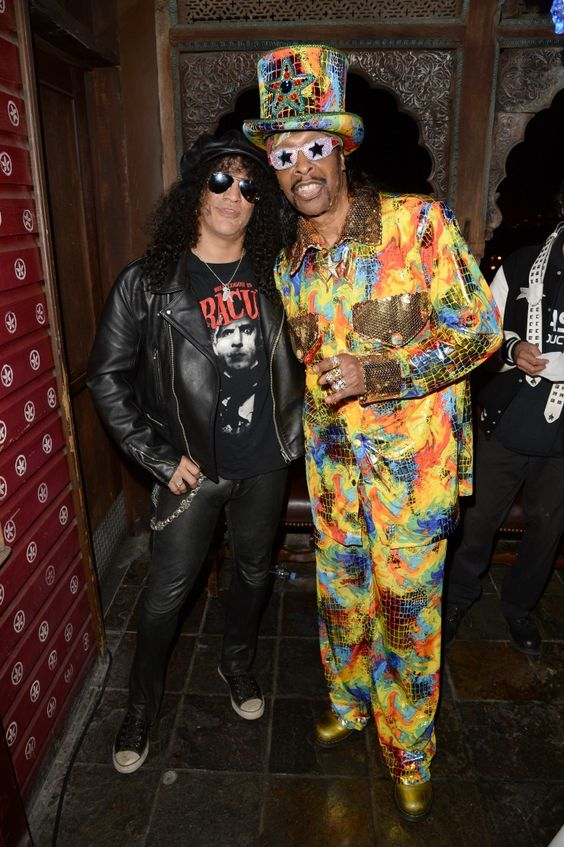 """Guitar legend Slash and bass master Bootsy Collins connect at the """"BandFuse: Rock Legends"""" video game launch event on Nov. 12 in West Hollywood, Calif."""