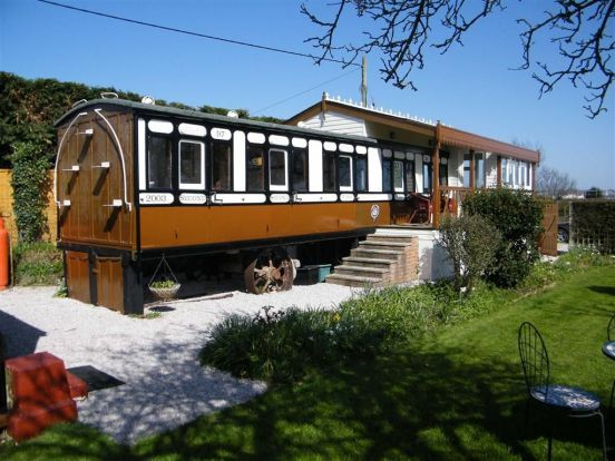 Railroad car homes buscar con google caboose living for Carriage homes for sale
