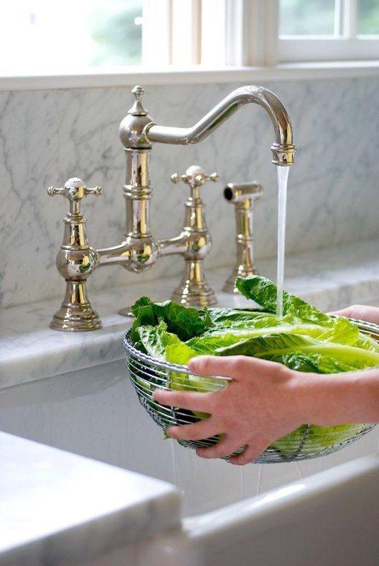 brass bridge faucet with farmhouse sink