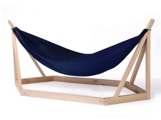 Dissidence, Laurent Corio for Tecsabois: portable indoor and outdoor hammock structure, wooden structure, moveable frame holds the waxed cotton hammock in place, metal rings slip over the frame and can be easily removed, collapsible.