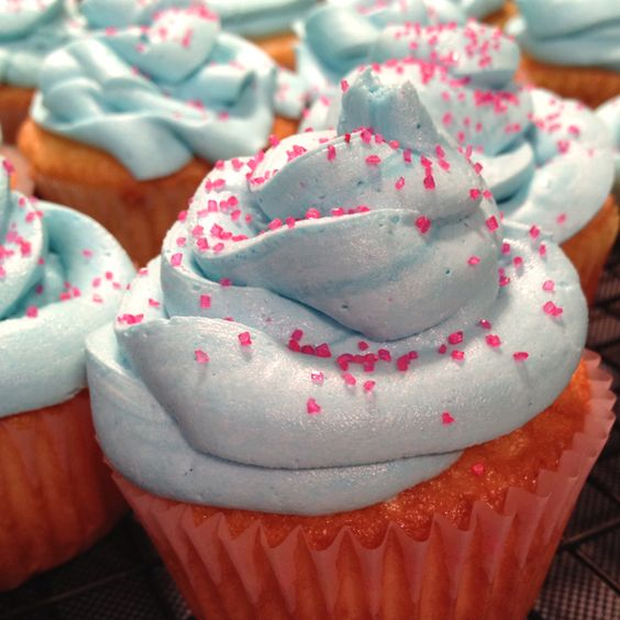 Cotton Candy Cupcakes using white cake mix and cotton candy flavoring in place of vanilla extract in the homeade buttercream icing!
