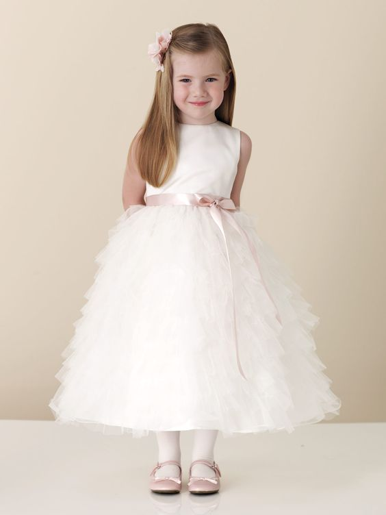 Sleeveless satin, tulle and organza tea-length dress with satin ribbon tie at waist, multi-tiered and ruffled tulle full skirt. Also available in baby sizes 6 mos. – 24 mos. as 110306B, also in Pink/Ivory. Sizes: 2 – 16