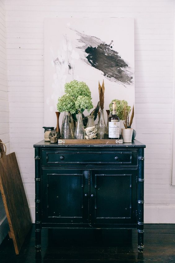 Rustic elegant vintage vignette upon a country cabinet. Inside Interior Designer Leanne Ford's Renovated Pennsylvania Schoolhouse.