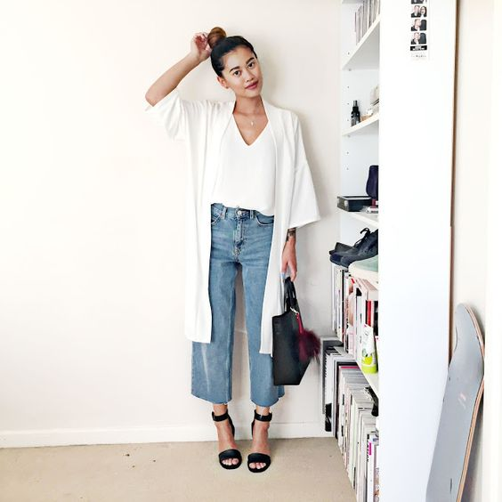 long white cardigan, white tank, light wash cropped jeans and black heels.