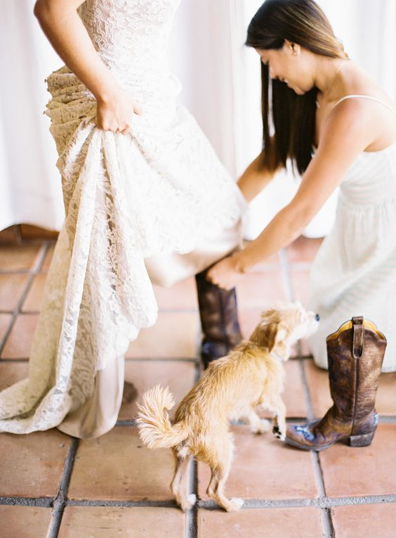 The bride wears cowboy boots , Anna Maier Ulla Maija Wedding Dress, a Floral Crown for a rustic romance wedding in Texas