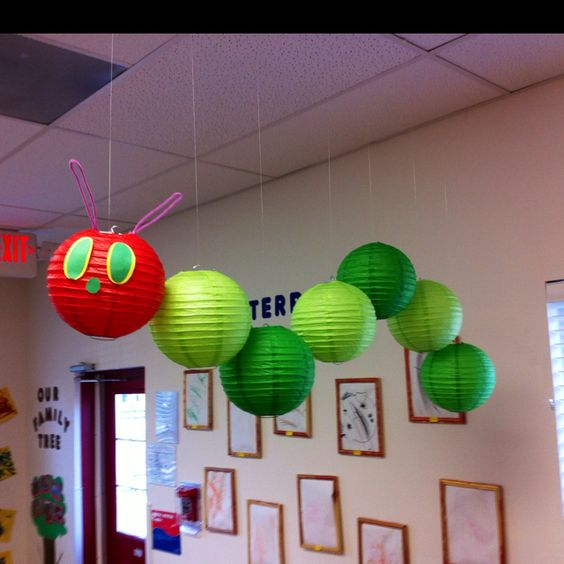 "Very Hungry Caterpillar Mobile. Hang 8"" lanterns (1 red, 6 in two shades of green) with different lengths of fishing line. Use pipe cleaners for antennae and construction paper for eyes and nose. Comes out so cute!"