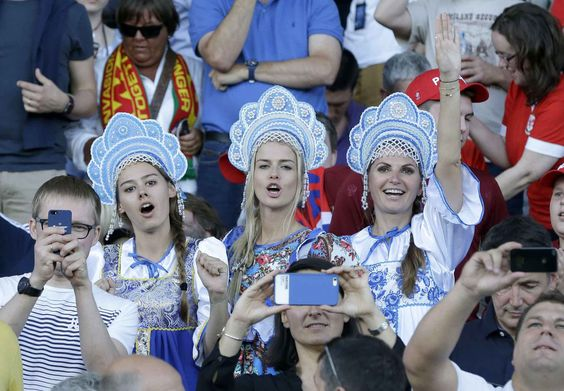 Russian fans wearing traditional outfits cheer from the stands before the Euro 2016 Group B soccer match between Russia and Wales at the Stadium municipal in Toulouse, France, Monday, June 20, 2016. (AP Photo/Thanassis Stavrakis)/XVG103/861946966895/1606202344