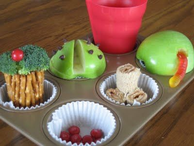 Muffin Tin Mom!  Amazing idea to serve lunch/snack in a muffin tin - even a spot for the cup!  I don't even think I'd have to make creative food for them to eat it!
