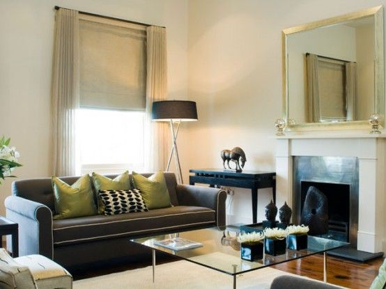 I love this brown and green living room the neutral walls for Neutral green living room