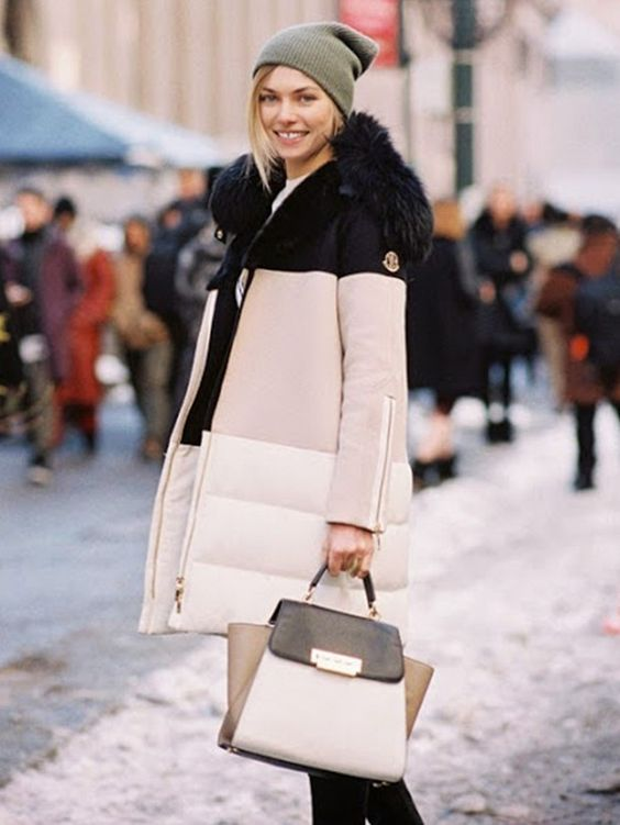 Jessica Hart battles the cold in a stylish color block puffer jacket + matching purse: