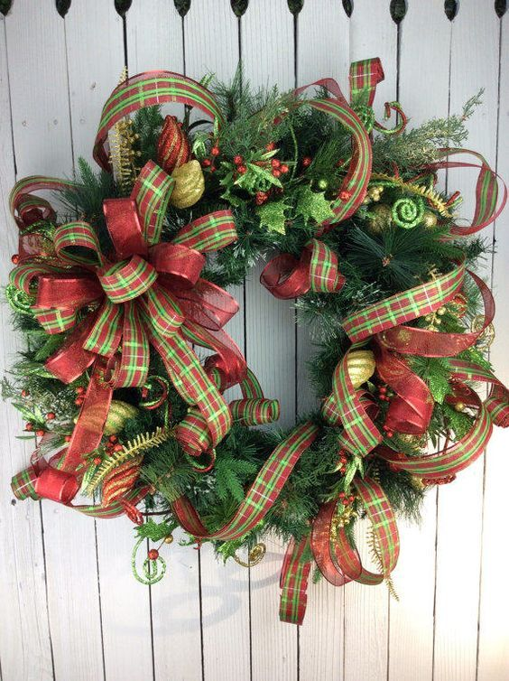 Elegant Christmas wreaths dress up any door or wall for the holidays. Greet guests with a wreath on your front door. Merry Christmas!: