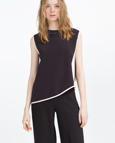 Image 2 of CONTRAST TOP from Zara:  Diagonals and contrast across the hip line breaks up the appearance of width at the hips. Diagonal lines can draw the eye or down and away from the hip area. It's a slimming look.