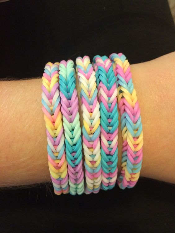 Rainbow Loom Fishtail bracelets in pastel colours including Glow in the Dark bands :D