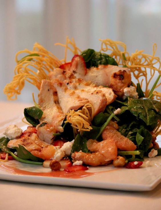 """Spinaci con Pollo e Gamberi"" dish has both…Grilled Chicken Breast, Grilled Scampi, Baby Spinach, Strawberries, Grapefruit, Caramelized Hazelnuts, Goat Cheese, served in an Angel Hair Basket with Low Fat Raspberry Dressing."