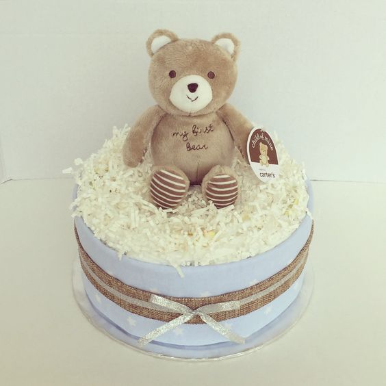 Baby Boy Diaper Cake - Baby Shower Gift or Centerpiece - http://www.babyshower-decorations.com/baby-boy-diaper-cake-baby-shower-gift-or-centerpiece.html