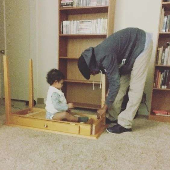 """Helping daddy set up the desk. (""""Helping"""")"""