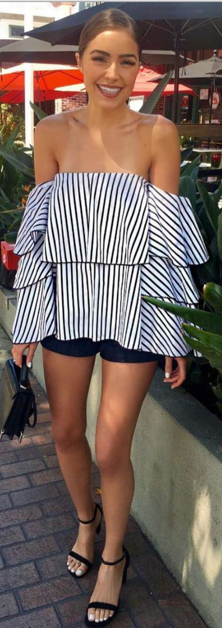 Olivia Culpo: Shoes – Stuart Weitzman  Purse – Mackage Rubie  Shirt – Caroline Constas