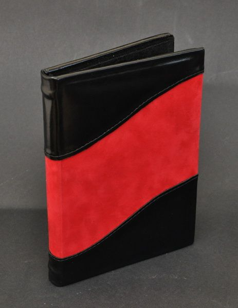 DVD cases made of Genuine leather and red velvet. I take custom orders for leather photo albums and journals and ship world wide!!!  http:www.mandragos.blogspot.ro