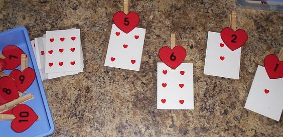Match number clothespins to cards with hearts- would be great using playing cards: