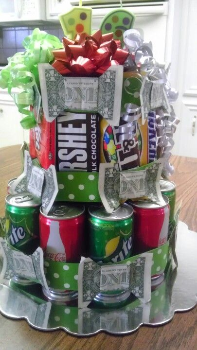 Made this for my niece's  16th birthday with her favorite drinks and candy and money bows.