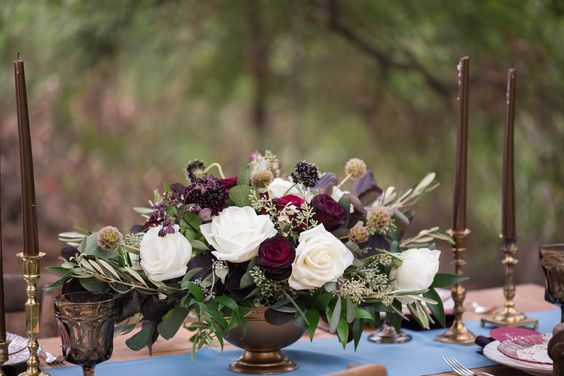 Dark plum and eggplant wedding centerpiece inspiration with gold accents. White roses, blackberry scabiosa, scabiosa pods, olive and eucalyptus create this wedding centerpiece, photographed by Caitlin Gerres Photography