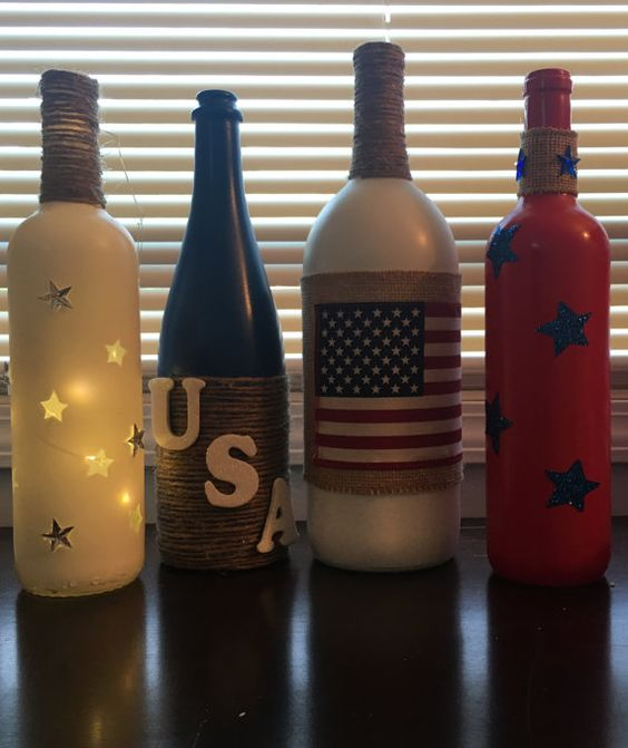 Lovely 4th of July Wine Bottles. Set of 4 wine bottles. It would make a great decor piece. $59. https://www.etsy.com/listing/387362016/july-4th-wine-bottle-decor