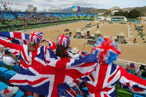 Fans cheer as Charlotte Dujardin of Great Britain riding Valegro competes in the Mens/Womens Team Dressage Grand Prix event on Day 6 of the Rio 2016 Olympic Games at the Olympic Equestrian Centre on August 11, 2016 in Rio de Janeiro, Brazil.
