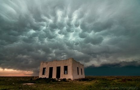Just viewed on 72dpi.com: Taken south of Lamar in Southwest Colorado, as a severe storm hit the abandoned ruins of a place in the absolute middle of nowhere.  These clouds are called Mammatus, and are formed by pockets of turbulence within a thunderstorm that protrude downwards out of the cloud.