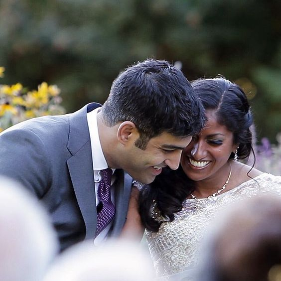 Cute candid photo of Chitra and Cyrus at their wedding ceremony at Gorge Crest Vineyards in Oregon :) // movingpictureweddings.com // wedding photo ideas
