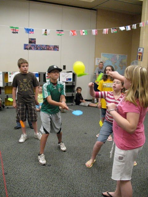 Flyswatter Badminton:  Use flyswatters and a balloon.  Team that the balloon lands on picks a card with a note on it.  At the end of the game the teams add up their note values to use as points.