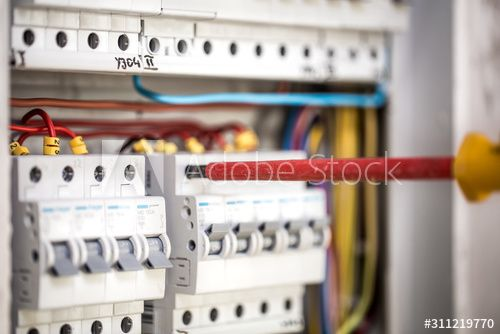 Man An Electrical Technician Working In A Switchboard With Fuses Installation And Connection Of Electrical Equip In 2020 Electrical Equipment Installation Technician