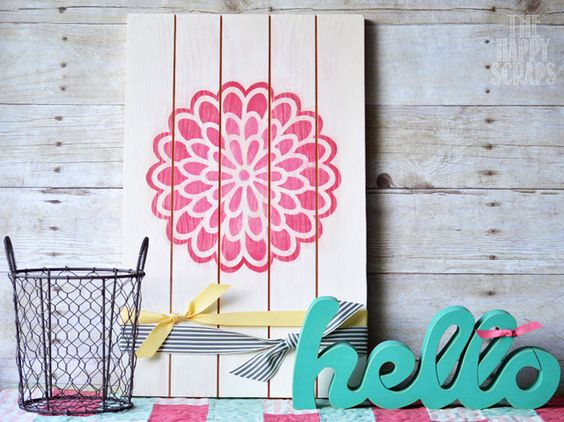 Use your Cricut Explore to create a stencil to paint an ombre Dahlia on a sign to display in your home.