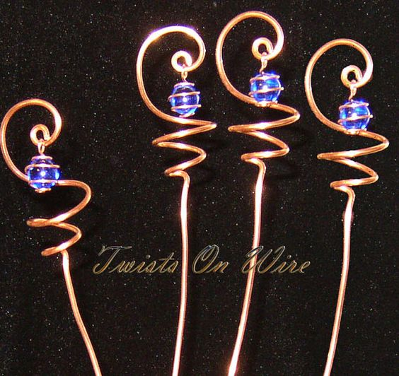 4 Handcrafted Solid Copper & Cobalt Blue Glass Sun Catcher Plant Stakes. Each one measures roughly 21 inches long and 1 1/2 inches wide. To view all my items: http://www.etsy.com/shop/TwistsOnWire