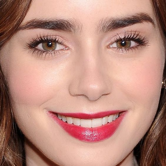 The lips! The hair! The brows! Drool over this Lily Collins look and then copy it for your next holiday party: http://beautyeditor.ca/2013/12/09/lily-collins-makeup/