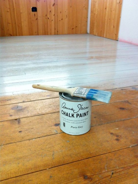 DIY:  How to Paint and Lacquer a Wood Floor with Annie Sloan's Products - a salon owner painted her busy salon floors with Paris Grey and sealed it with Lacquer. This post has tips on how it was done - via The Purple Painted Lady
