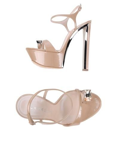 Casadei sandals (page 4): Details: varnished effect, solid color, buckling ankle strap closure, round toeline, rhinestone detailing, leather sole, covered heel
