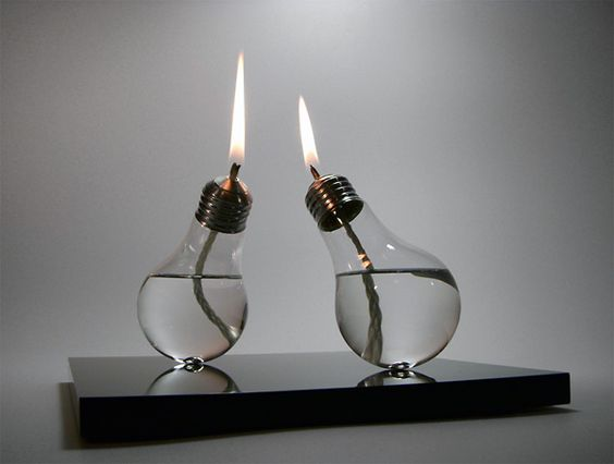 A modern-day lightbulb that has travelled back in time, providing light as a traditional oil lamp.