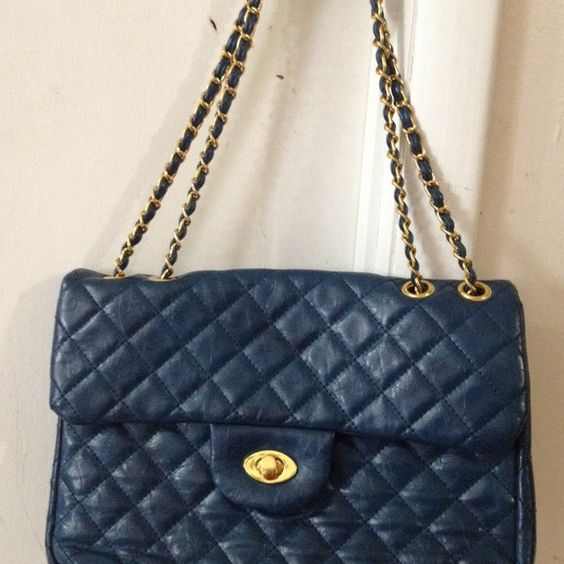 Blue Bag  Looks like Channel bag. great condition. has pocket inside. perfect to wear for party night any occasion and can wear casual.looks brand new. Bags
