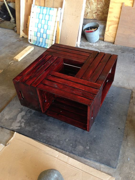 DIY wine crate coffee table!!! $12.99 wine crates from michaels...stained them and then nailed them together along with a square piece of plywood to the bottom...and added 4 caster wheels