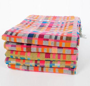 Love Blanket by Holly Berry. These super soft luxury blankets are designed by British weaver Holly Berry. Each blanket is made from cashmere and merino wool at a 250 year old mill in Scotland. Using a kaleidoscope of stunning colours, the double sided design spells out the word LOVE in Morse code. www.lin-morris.com